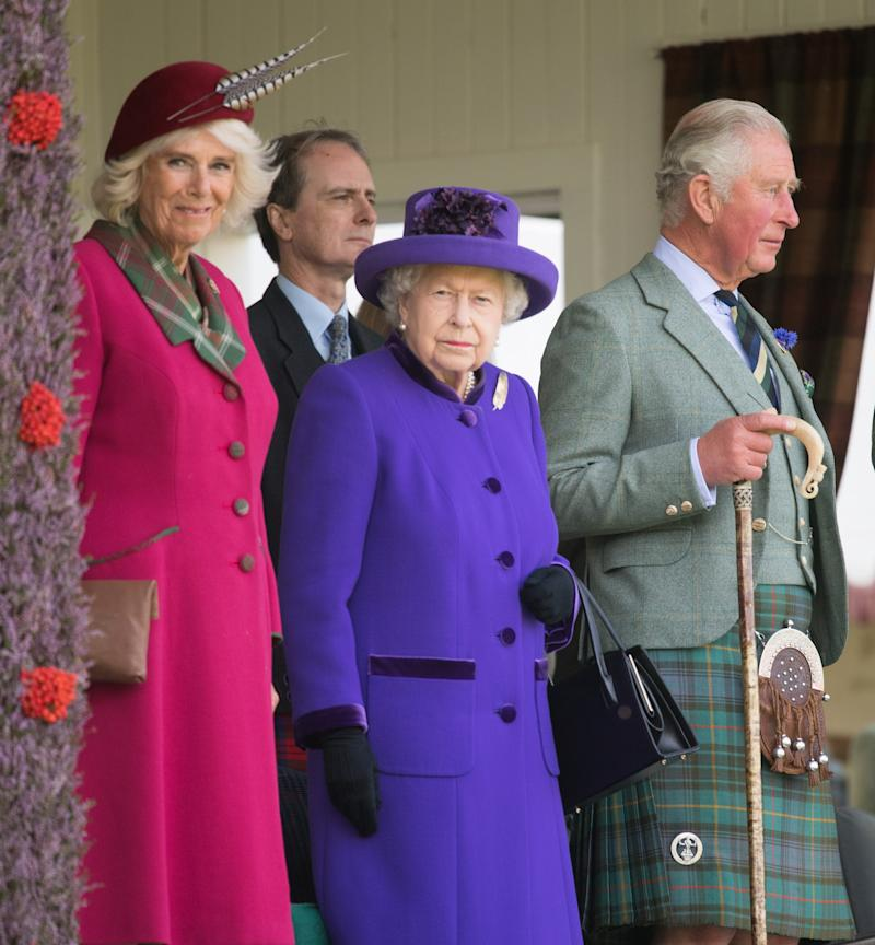 Queen Elizabeth, accompanied by Camilla, Duchess of Rothesay, and Prince Charles, Duke of Rothesay (as they are known in Scotland.)