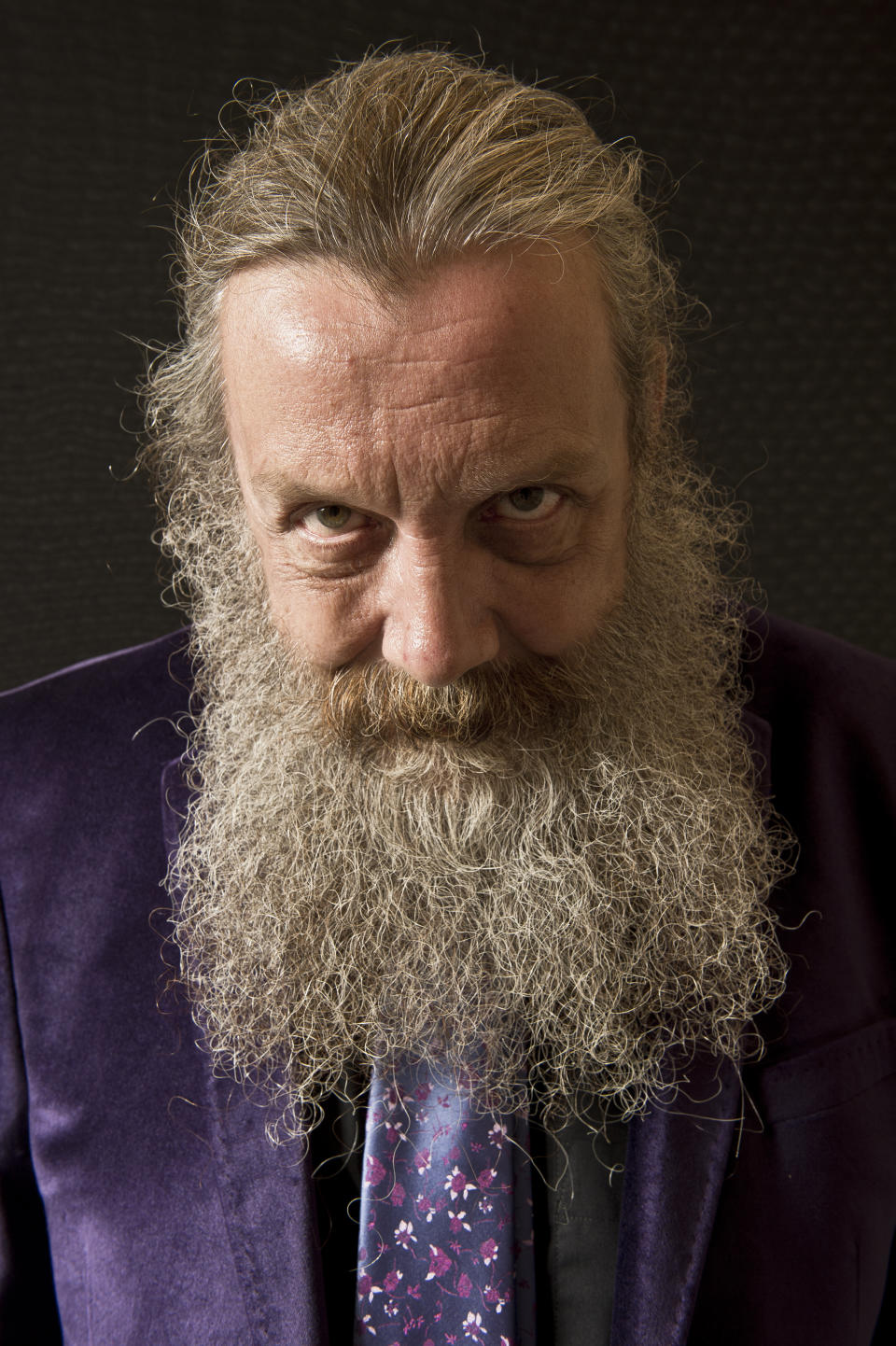 LONDON, UNITED KINGDOM - SEPTEMBER 6: Portrait of English comic book writer Alan Moore, taken on September 6, 2013. Moore is often considered the finest writer in the comics medium, and is best known for his graphic novels Watchmen and V For Vendetta. (Photo by Kevin Nixon/SFX Magazine/Future via Getty Images)