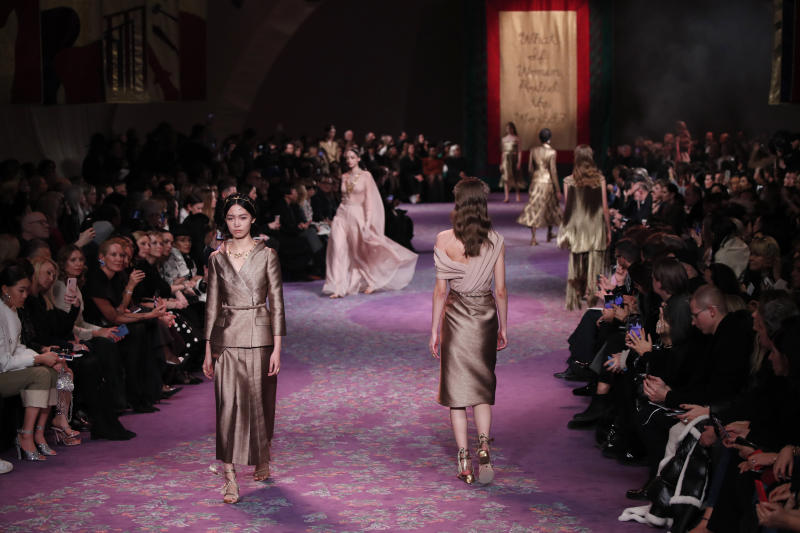 Models wear creations for the Dior Haute Couture Spring/Summer 2020 fashion collection presented Monday Jan. 20, 2020 in Paris. (AP Photo/Francois Mori)
