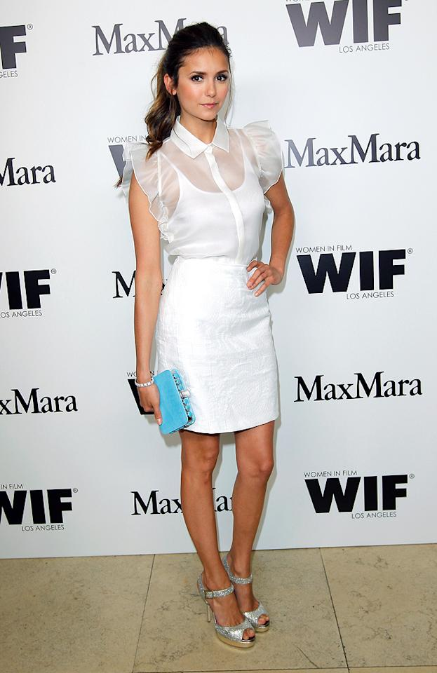 """Vampire Diaries"" hottie Nina Dobrev also loves Max Mara and wore this adorable MM getup to a recent Women in Film event in West Hollywood. In addition to her sleeveless top and embroidered skirt, she hit the pavement in sparkling silver peep-toes. (6/11/2012)"