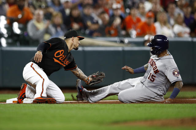 Baltimore Orioles third baseman Jace Peterson tags out Houston Astros' Martin Maldonado as Maldonado tries to advance on Jose Altuve's fly-out in the third inning of a baseball game, Friday, Sept. 28, 2018, in Baltimore. (AP Photo/Patrick Semansky)