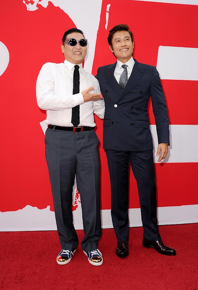 "LOS ANGELES, CA - JULY 11:  Rapper Psy (L) and actor Byung-hun Lee attend the premiere of Summit Entertainment's ""RED 2"" at Westwood Village on July 11, 2013 in Los Angeles, California.  (Photo by Kevin Winter/Getty Images)"