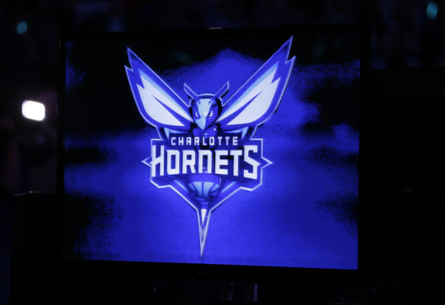 The new logo of the Charlotte Hornets is displayed on a video monitor during a halftime ceremony of an NBA basketball game between the Charlotte Bobcats and the Utah Jazz in Charlotte, N.C., Saturday, Dec. 21, 2013. The Bobcats will change their name to the Hornets next season. (AP Photo/Chuck Burton)
