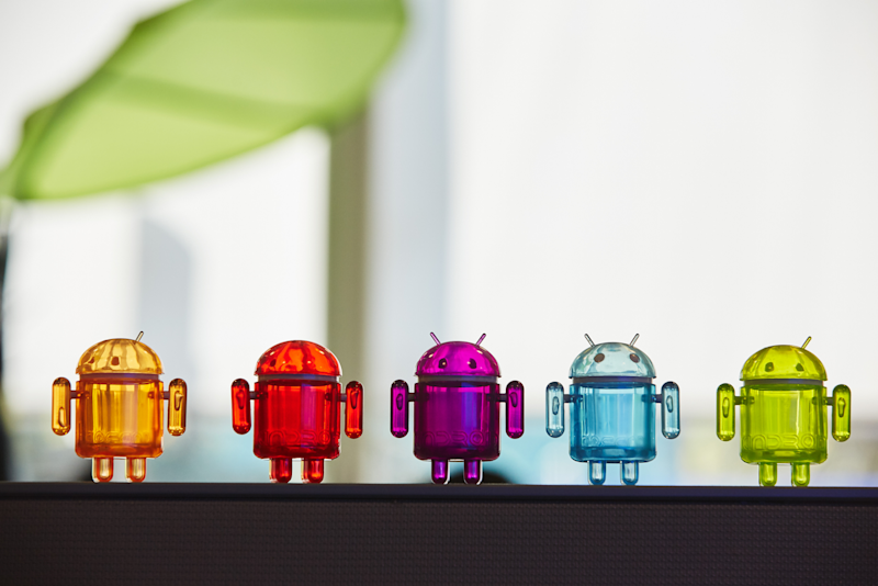 A row of glass Android figurines.