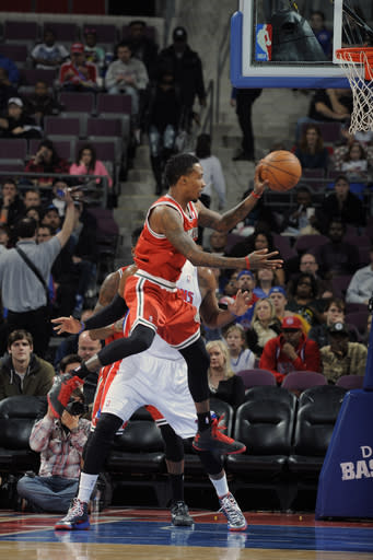 AUBURN HILLS, MI - JANUARY 29: Brandon Jennings #3 of the Milwaukee Bucks passes in mid-air against the Detroit Pistons during the game on January 29, 2013 at The Palace of Auburn Hills in Auburn Hills, Michigan. (Photo by Allen Einstein/NBAE via Getty Images)