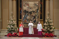 Pope Francis, center, delivers the Urbi et Orbi (Latin for 'to the city and to the world' ) Christmas' day blessing inside the blessing hall of St. Peter's Basilica, at the Vatican, Friday, Dec. 25, 2020. (Vatican Media via AP)