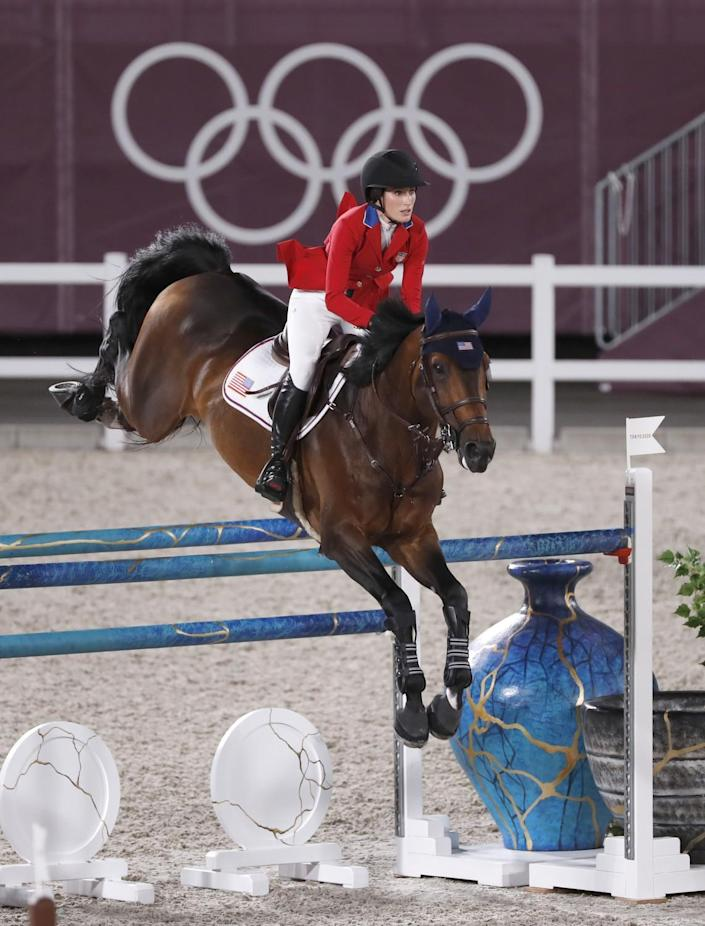 Jessica Springsteen clears a gate on horse Don Juan van de Donkhoeve during show jumping individual qualifying Tuesday.