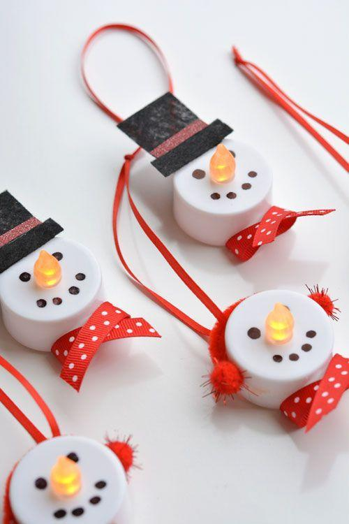 """<p>If you have a ton of battery-operated tea lights left over from all those <a href=""""https://www.goodhousekeeping.com/holidays/halloween-ideas/a22196/pumpkin-carving-tips/"""" rel=""""nofollow noopener"""" target=""""_blank"""" data-ylk=""""slk:Halloween pumpkins"""" class=""""link rapid-noclick-resp"""">Halloween pumpkins</a>, put 'em back to work by making them into too-cute snowmen. </p><p><a href=""""http://onelittleproject.com/tea-light-snowman-ornaments/2/"""" rel=""""nofollow noopener"""" target=""""_blank"""" data-ylk=""""slk:Get the tutorial at One Little Project »"""" class=""""link rapid-noclick-resp""""><em>Get the tutorial at One Little Project »</em></a></p>"""