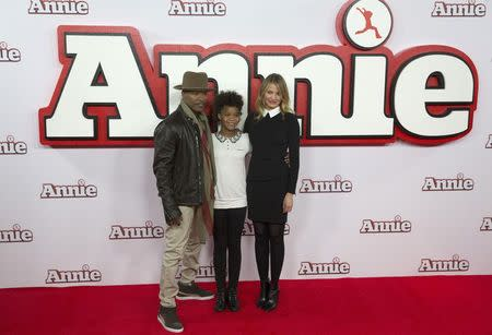 Actor Jamie Foxx, and actresses Quvenzhane Wallis and Cameron Diaz pose for photographers during a photocall for their film Annie, in central London