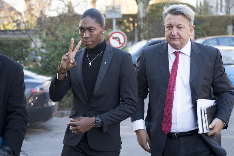 FILE - In a Monday, Feb. 18, 2019 file photo, South Africa's runner Caster Semenya, left, current 800-meter Olympic gold medalist and world champion, and her lawyer Gregory Nott, right, arrive for the first day of a hearing at the international Court of Arbitration for Sport, CAS, in Lausanne, Switzerland. On the 10th anniversary of Semenya blowing away the field in the 800 at the 2009 World Championships in Berlin, she won't comply with the International Association of Athletics Federations' latest version of a regulation to lower her level of natural testosterone.(Laurent Gillieron/Keystone via AP, File)