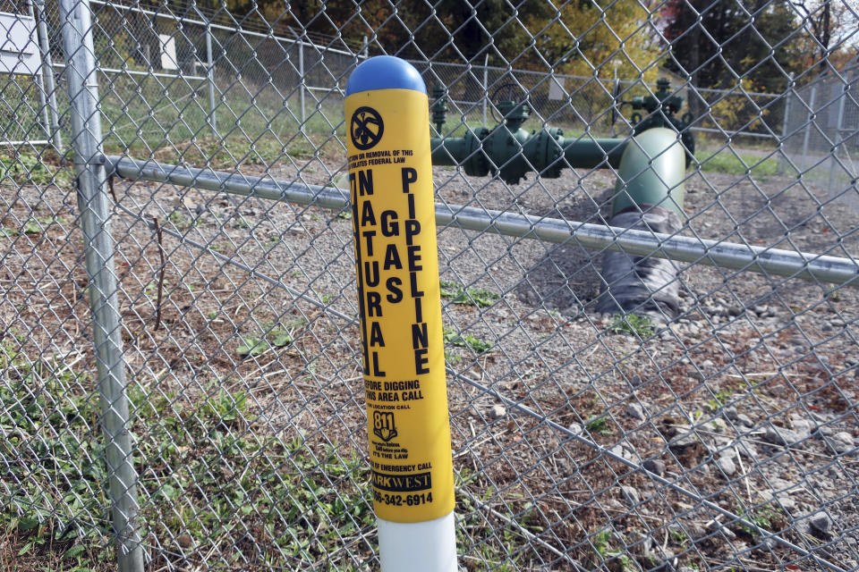 A MarkWest Liberty natural gas pipeline and fracking well cap is seen in Valencia, Pennsylvania on Wednesday, Oct. 14, 2020. President Trump accuses Joe Biden of wanting to ban fracking, a sensitive topic in the No. 2 natural gas state behind Texas. Biden insists he does not want to ban fracking broadly - he wants to ban it on federal lands and make electricity production fossil-fuel free by 2035. (AP Photo/Ted Shaffrey)
