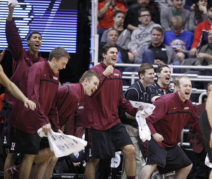 Harvard players celebrate on the bench after beating New Mexico during a second round game in the NCAA college basketball tournament in Salt Lake City Thursday, March 21, 2013. Harvard beat New Mexico 68-62. (AP Photo/George Frey)