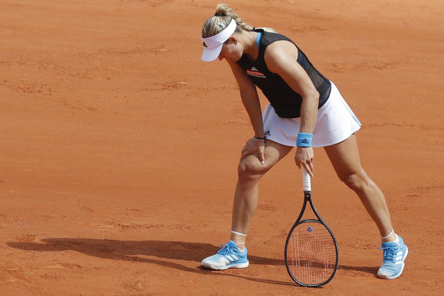 Germany's Angelique Kerber reacts after missing a shot against Russia's Anastasia Potapova during their first round match of the French Open tennis tournament at the Roland Garros stadium in Paris, Sunday, May 26, 2019. (AP Photo/Michel Euler )