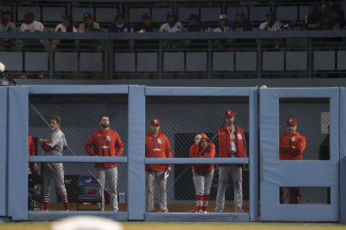 The St. Louis Cardinals bullpen watches the game during the seventh inning