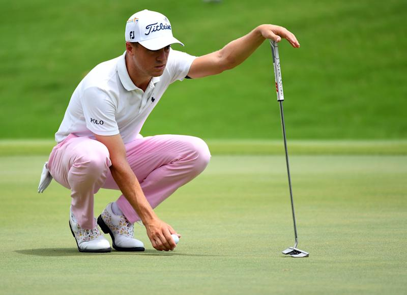 Aug 2, 2020; Memphis, Tennessee, USA; Justin Thomas lines up his putt on the first green during the final round of the WGC - FedEx St. Jude Invitational golf tournament at TPC Southwind. Mandatory Credit: Christopher Hanewinckel-USA TODAY Sports