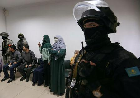 People attend a verdict hearing at a trial of Islamic State supporters, who attacked a National Guard facility in June, at a court in Aktobe, Kazakhstan, November 28, 2016. REUTERS/Stringer