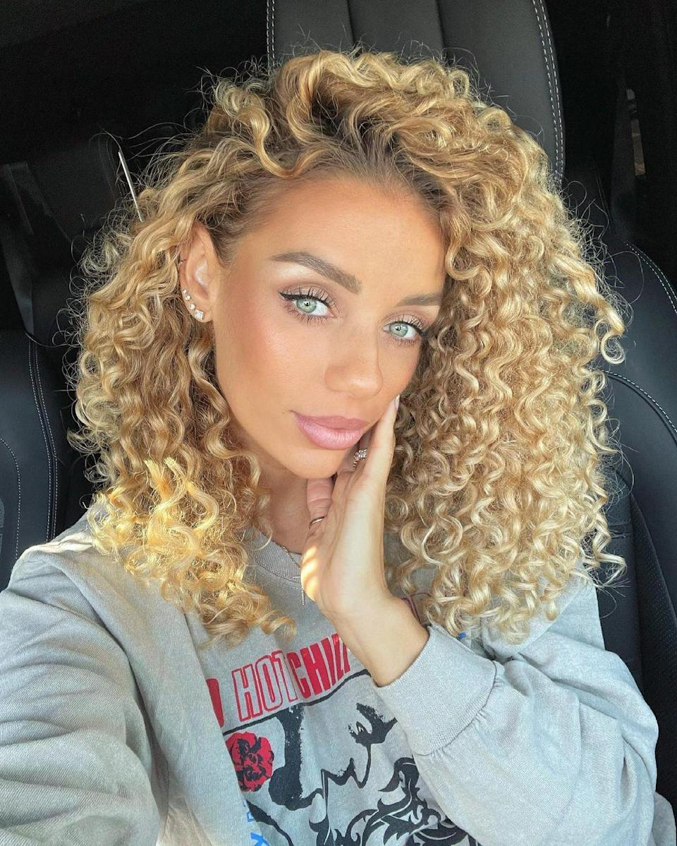 """If you have curls, consider going a little brighter this summer to make your texture really pop. Schaudt loves this unique golden hue and says to ask for a full balayage. """"Keep the pieces on the chunky so they don't get lost in the curls."""""""