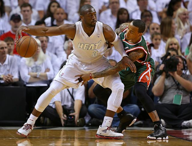 MIAMI, FL - APRIL 21: Monta Ellis #11 of the Milwaukee Bucks guards Dwyane Wade #3 of the Miami Heat during Game 1 of the Eastern Conference Quarterfinals of the 2013 NBA Playoffs at American Airlines Arena on April 21, 2013 in Miami, Florida. NOTE TO USER: User expressly acknowledges and agrees that, by downloading and or using this photograph, User is consenting to the terms and conditions of the Getty Images License Agreement. (Photo by Mike Ehrmann/Getty Images)