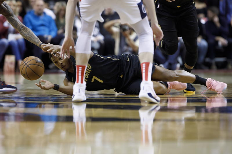 Toronto Raptors guard Kyle Lowry (7) reaches for a loose ball during the first half of the team's NBA basketball game against the Washington Wizards on Friday, Jan. 17, 2020, in Toronto. (Cole Burston/The Canadian Press via AP)