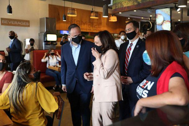 PHOTO: Democratic Vice Presidential Nominee Sen. Kamala Harris and her husband, Doug Emhoff greet people during a stop at Amaize restaurant on Sept. 10, 2020, in Doral, Fla. (Joe Raedle/Getty Images, FILE)