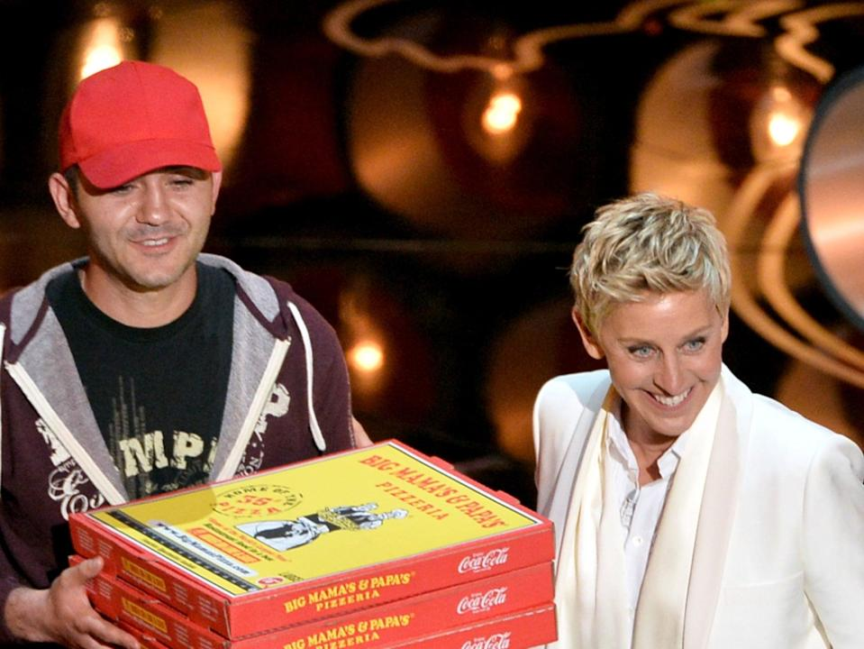 <p>Oscar hosts, like Ellen DeGeneres in 2014, had to justify their presence through an increasingly ludicrous set of stunts</p> (Getty)