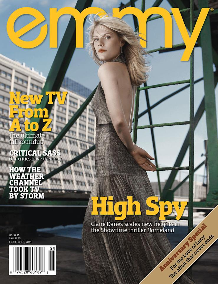 """<a href=""""/claire-danes/contributor/31463"""">Claire Danes</a> strikes a pose on the cover of Emmy magazine's latest issue, on newsstands now. During last year's awards season, Danes picked up Emmy, Golden Globe, and SAG wins for her performance as Temple Grandin in the HBO TV movie """"<a href=""""/temple-grandin/show/28368"""">Temple Grandin</a>."""" This fall, the talented actress tackles another cable project, playing a CIA agent in Showtime's new drama series """"<a href=""""/homeland/show/47337"""">Homeland</a>."""" Click through this slideshow to see all of Danes' photos inside the magazine and what she had to share."""