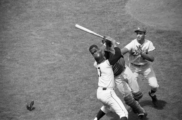 Juan Marichal, holding bat, attacked John Roseboro as Sandy Koufax closes in. (Getty Images)
