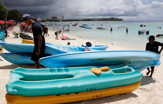 <p>Tourists frolic along the Tumon beach on the island of Guam, a U.S. Pacific Territory, August 10, 2017. (Erik De Castro/Reuters) </p>