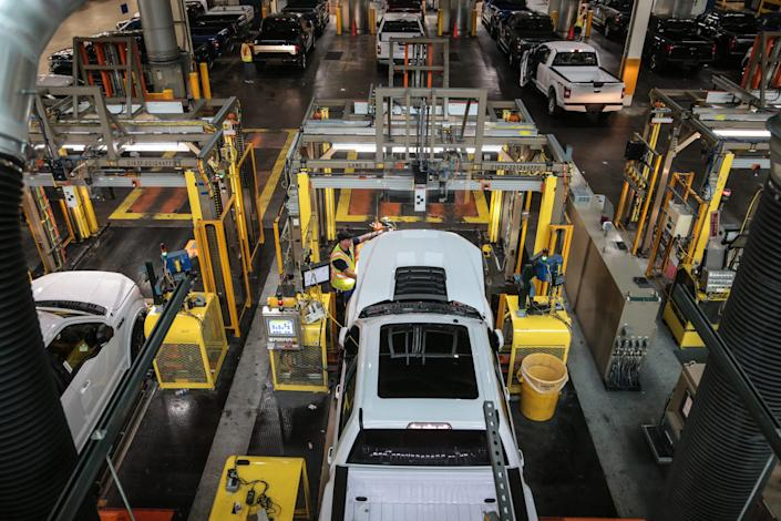 Workers check Ford F-150 trucks being built at the Ford Rouge Plant in Dearborn on Thursday, September 27, 2018.
