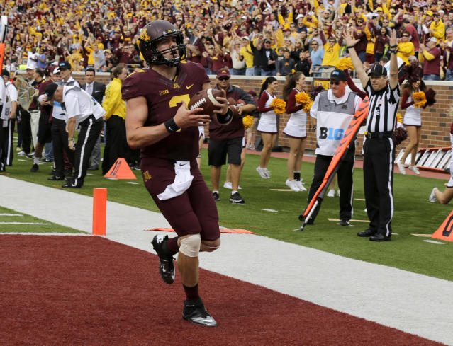 Minnesota quarterback Mitch Leidner (7) carries the ball into the end zone for a touchdown during the first quarter of an NCAA college football game against San Jose State in Minneapolis, Saturday, Sept. 21, 2013. (AP Photo/Ann Heisenfelt)