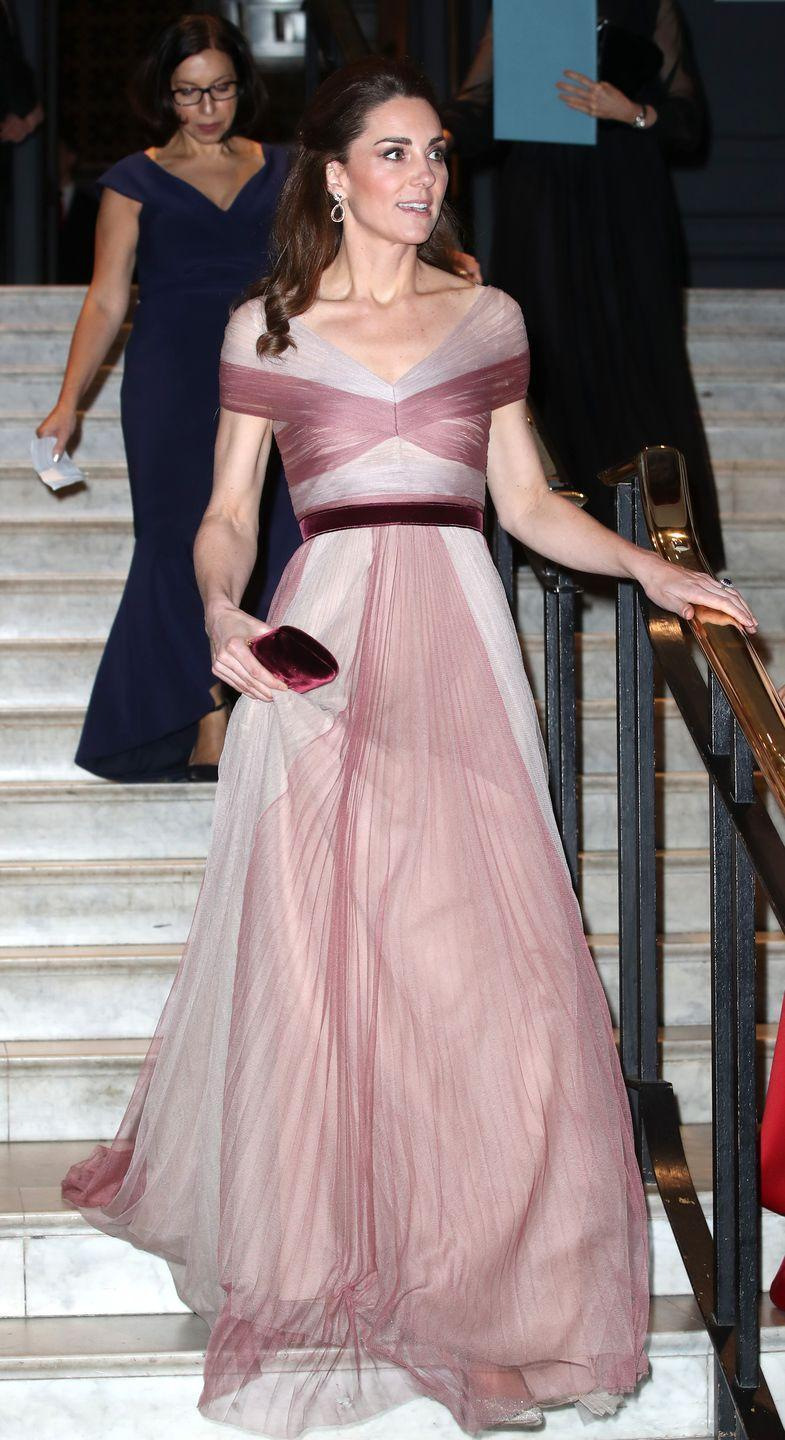 <p>Kate Middleton looked like a Disney princess, as she ascended the staircase in a two-toned chiffon gown by Gucci. The Duchess was attending a gala dinner at the Victoria and Albert Museum in London. </p>