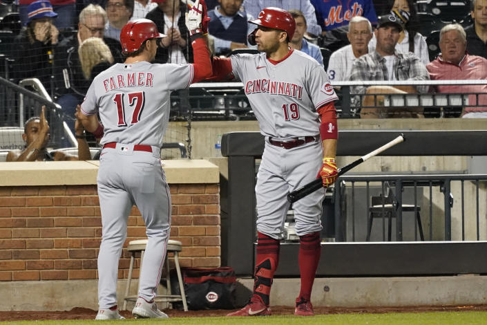 Cincinnati Reds' Kyle Farmer (17) celebrates with Joey Votto (19) after hitting a solo home run in the fifth inning of the baseball game against the New York Mets, Saturday, July 31, 2021, in New York. (AP Photo/Mary Altaffer)