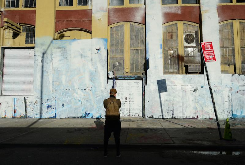 A visitor takes in the whitewashed walls that once displayed some of the world's best graffiti art.