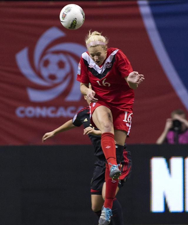VANCOUVER, CANADA - JANUARY 27: Lauren Sesselmann #16 of Canada out jumps Teresa Novola #7 of Mexico for the loose ball during the first half of semifinals action of the 2012 CONCACAF Women's Olympic Qualifying Tournament at BC Place on January 27, 2012 in Vancouver, British Columbia, Canada. (Photo by Rich Lam/Getty Images)