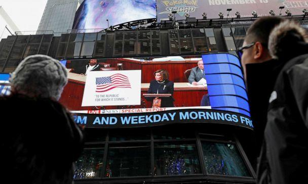 PHOTO: House Speaker Nancy Pelosi is seen on a giant screen outside ABC News studios in Times Square, speaking to the U.S. House of Representatives, in New York, Dec. 18, 2019. (Shannon Stapleton/Reuters)