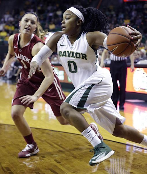 FILE - In this Feb. 21, 2014 file photo, Baylor guard Odyssey Sims (0) drives past Oklahoma guard Nicole Kornet (1) during the first half of an NCAA college basketball game in Waco, Texas. Sims was selected to The Associated Press women's basketball All-America team, released Tuesday, April 1, 2014. (AP Photo/LM Otero, File)