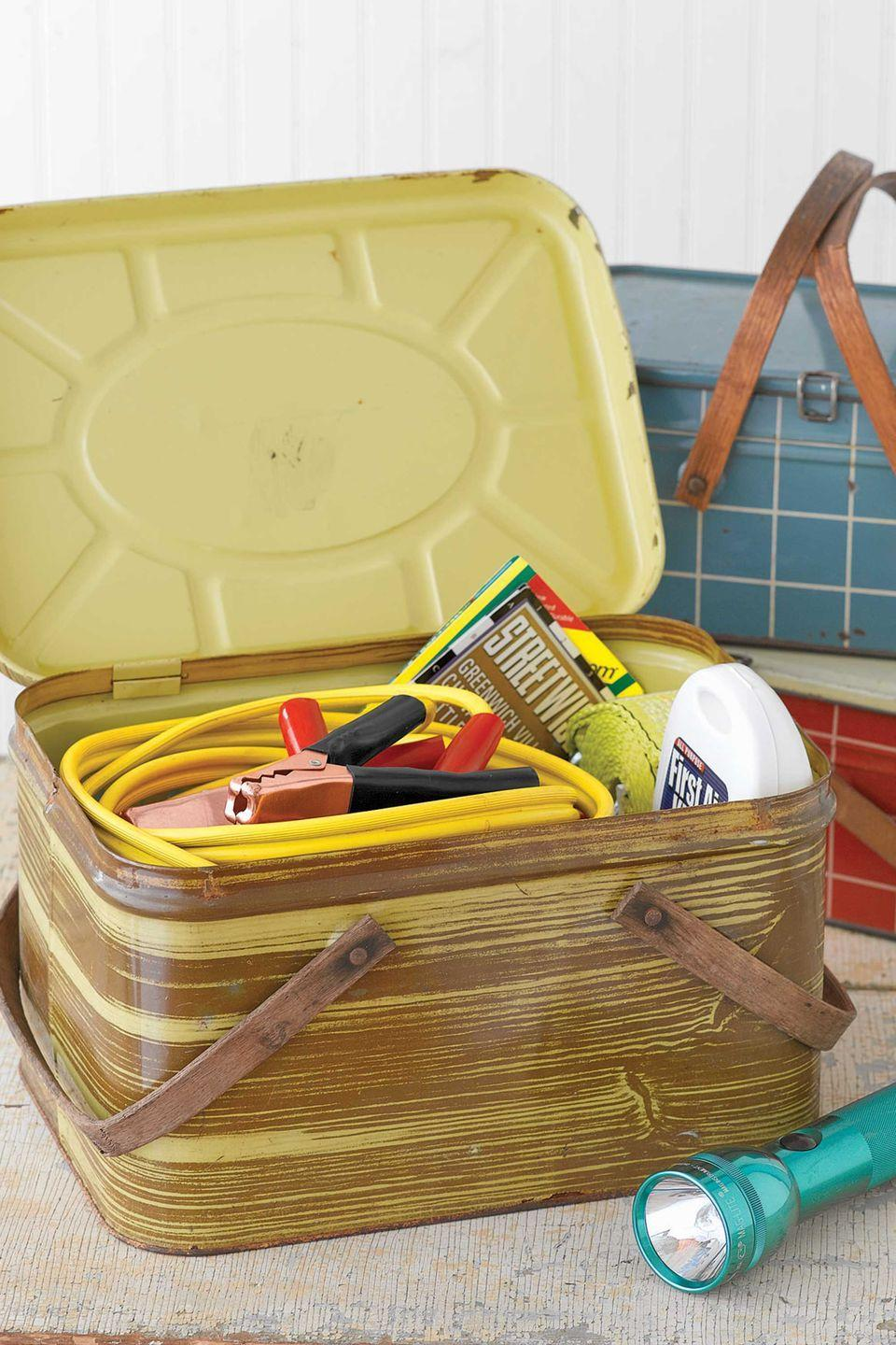 <p>Use a sturdy vintage basket to create an emergency kit for Dad's car. Lithographed tin picnic baskets with swing handles, which were originally made from the 1930s through the 1950s, are now popular collectibles. Simply fill with jumper cables, road flares, a first aid kit and other essentials to stow in the trunk.</p>