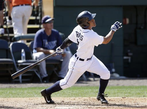 Detroit Tigers' Devon Travis watches his two-run home run during the eighth inning of a spring training baseball game against the Tampa Bay Rays, Tuesday, March 19, 2013 in Lakeland, Fla. (AP Photo/Carlos Osorio)
