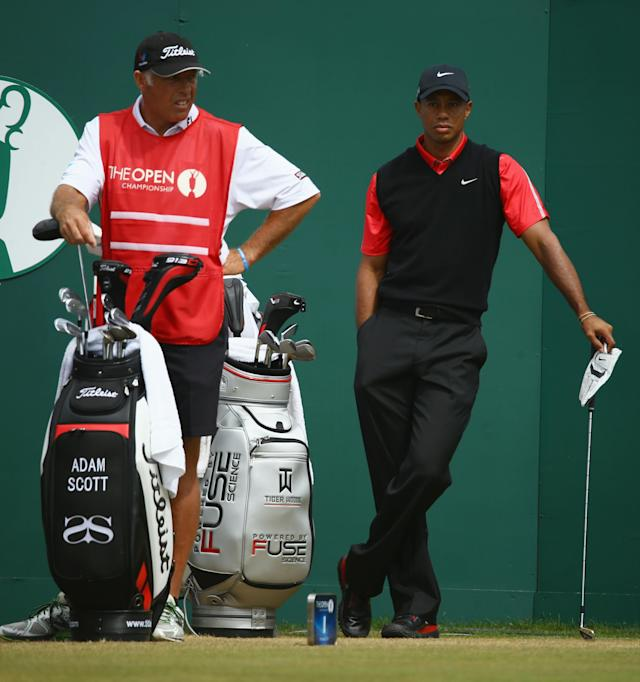 GULLANE, SCOTLAND - JULY 21: Caddie Steve Williams for Adam Scott of Australia (not seen) stands by Tiger Woods of the United States before Woods tees off on the 1st hole during the final round of the 142nd Open Championship at Muirfield on July 21, 2013 in Gullane, Scotland. (Photo by Matthew Lewis/Getty Images)