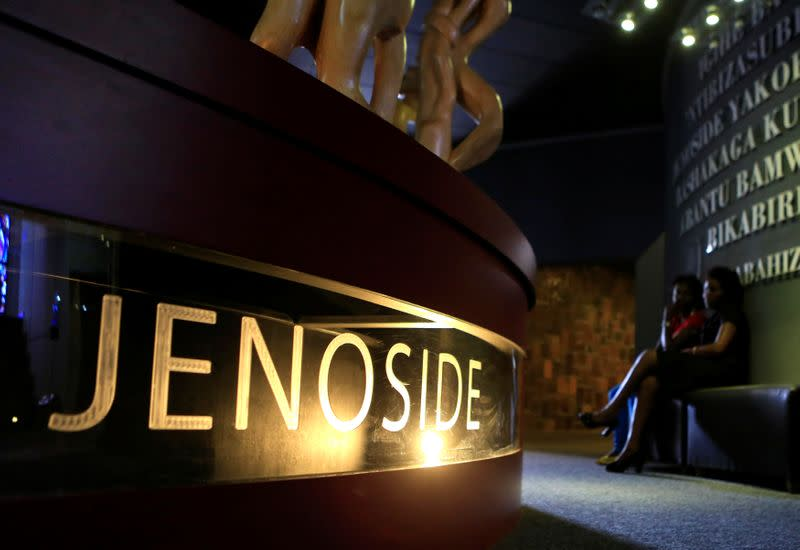 FILE PHOTO: People sit inside the Kigali Genocide Memorial Museum