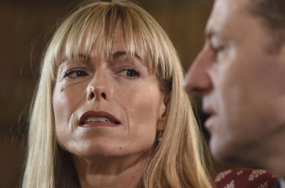 """Kate and Gerry McCann, whose daughter Madeleine disappeared from a holiday flat in Portugal ten-years ago, react during a BBC TV interview in Loughborough, England, Friday April 28, 2017.  The parents of Madeleine McCann have vowed to do """"whatever it takes for as long as it takes"""" to find her as they prepare to mark the tenth anniversary of her disappearance on the evening of 3 May 2007, from her bed in a holiday apartment in Praia da Luz resort in the Algarve, Portugal. (Joe Giddens/Pool via AP)"""