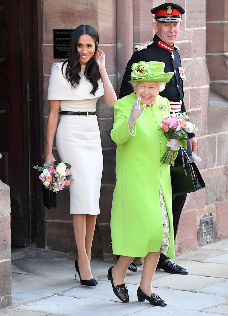 Meghan, Duchess of Sussex and Queen Elizabeth II depart Chester Town Hall, where they attended lunch as guests of Chester City Council on June 14, 2018 in Chester, England.