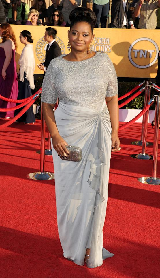 "But Stone wasn't the only ""Help"" star turning heads on the red carpet. Supporting actress winner Octavia Spencer oozed elegance in an embroidered Tadashi Shoji dress, chic updo, and Irene Neuwirth earrings."