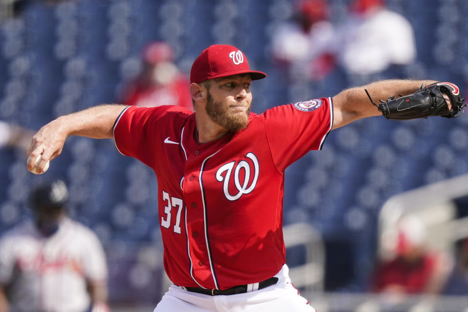 Washington Nationals starting pitcher Stephen Strasburg throws during the first inning of the second baseball game of a doubleheader against the Atlanta Braves, at Nationals Park, Wednesday, April 7, 2021, in Washington. (AP Photo/Alex Brandon)