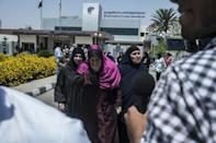 Family members of passengers who were flying aboard an EgyptAir plane that vanished from radar en route from Paris to Cairo, are transported to a gathering point at Cairo airport, on May 19, 2016