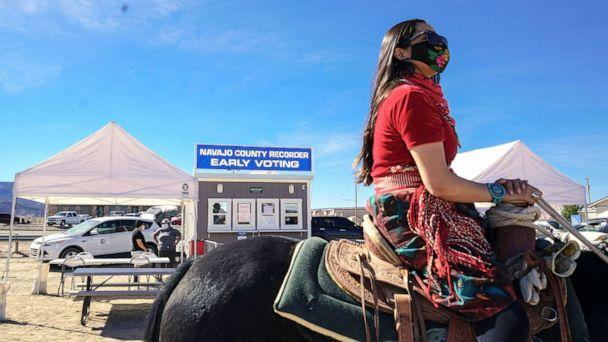 PHOTO: Activist Allie Young, of the Dine, leads a group of Native Americans as they ride on horseback to the polls in Kayenta, Ariz., Oct. 20, 2020.  (Courtesy Talia Mayden)