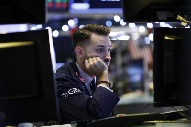 Specialist Matthew Greiner works at his post on the floor of the New York Stock Exchange, Thursday, Dec. 27, 2018. Wall Street's wild Christmas week goes on, with the Dow Jones Industrial Average slumping 300 points at the open Thursday, a day after notching its biggest-ever point gain. (AP Photo/Richard Drew)