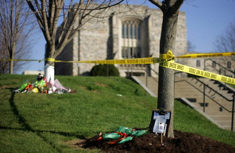 Memorials for the 32 victims of the 2007 Virginia Tech shooting are pictured in front of Norris Hall on the school's Blacksburg, Virginia campus in April 2007 (AFP Photo/TIM SLOAN)