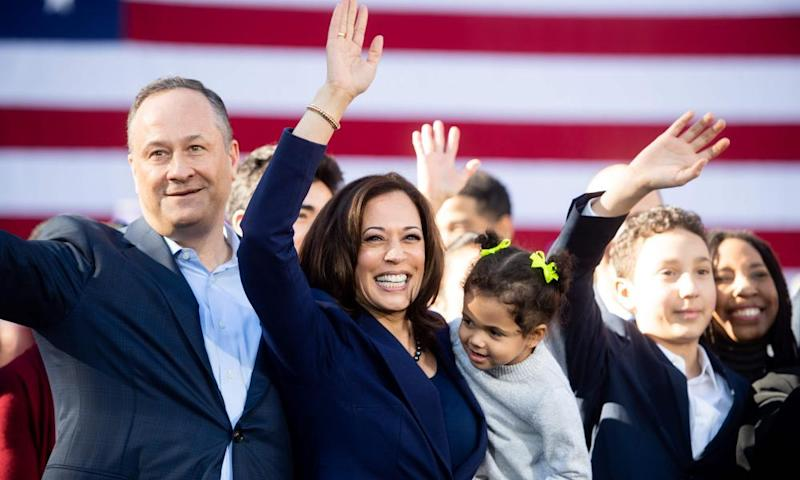 Kamala Harris waves next to her husband, Douglas Emhoff, during a rally launching her presidential campaign in January 2019 in Oakland.