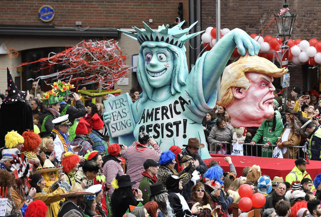 <p>A carnival float depicting the severed head of U.S. president Donald Trump and the statue of liberty is surrounded by carnevalists during the traditional street carnival parade in Duesseldorf, Germany, on Feb. 27, 2017. (Photo: Martin Meissner/AP) </p>